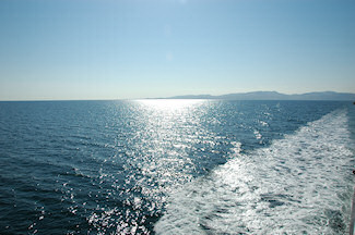 Picture of an island in beautiful sunshine seen from a ferry