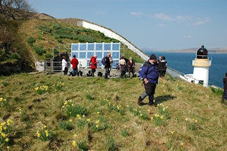 Picture of a group of walkers at a remote lighthouse