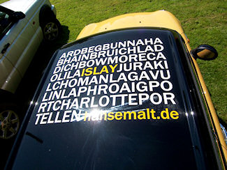 Picture of the roof of a car with the names of all Islay distilleries printed on it