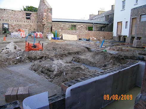 Picture of the foundation for an extension at a hotel