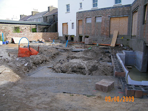 Picture of the foundations for an extension at the back of an under construction hotel