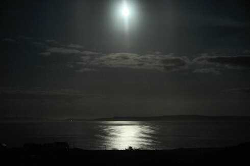 Picture of the moon over a sea loch, Loch Indaal on Islay
