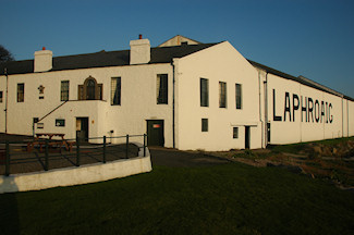 Picture of the Laphroaig distillery offices and the famous warehouse nr 1 in mild evening light