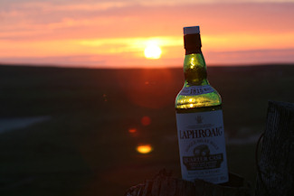 Picture of a bottle of Laphroaig Quarter Cask against a sunset