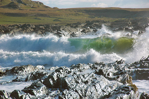 Picture of waves breaking on a rocky shore at the end of a beach