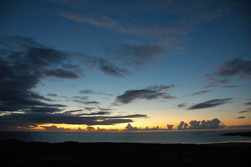 Picture of dramatic clouds at sunset over a wide bay on Islay