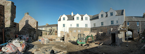 Panoramic picture of the back of an under construction hotel