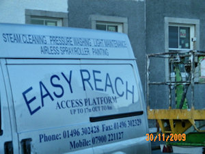 Picture of the side of a van with the Easy Reach company information