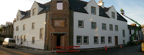 Picture of an under construction hotel, both wings painted, only the main portal awaiting completion