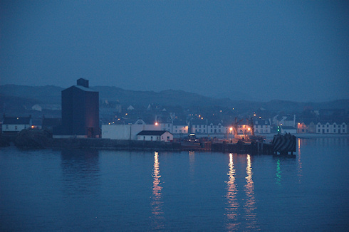 Picture of a small ferry terminal and a grain silo in the evening light