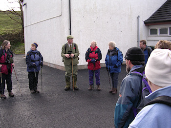 Picture of a gamekeeper welcoming walkers for a walk