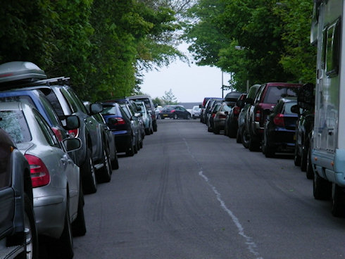 Picture of a road full of parked cars