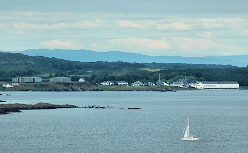 Picture of Laphroaig distillery on Islay seen from a hill in the distance