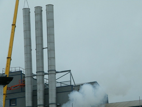 Picture of three metal chimneys at a maltings (closer view)