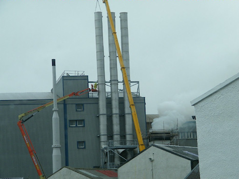 Picture of three chimneys being installed at the Port Ellen maltings on Islay