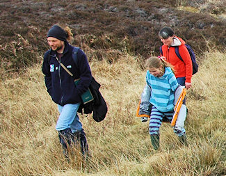 Picture of a family of three walking in the wilderness of Islay