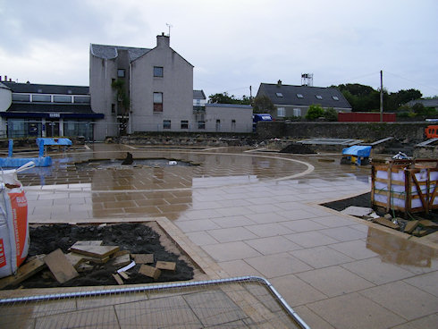 Picture of a town square under refurbishment, a look towards the back