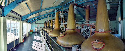 Small panoramic view of the inside of the still house of Laphroaig distillery on Islay