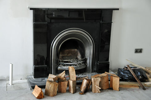 Picture of a fireplace in an under construction room