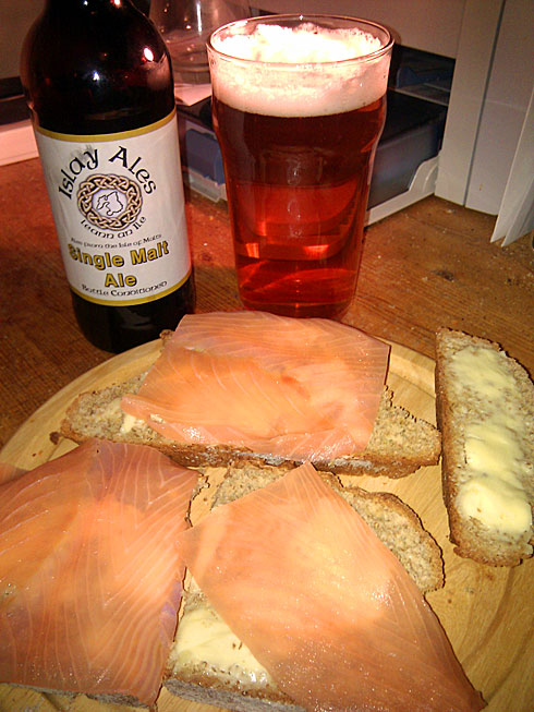 Picture of a soda bread served with smoked salmon and a pint of Islay Ale