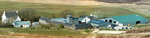 Panoramic picture of a farm distillery, Kilchoman distillery at Rockside Farm on Islay