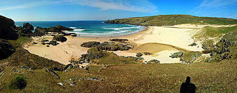 Picture of a panoramic view over a sandy bay and beach on a sunny day