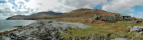 Panoramic view of a shoreline with a bothy, An Cladach on Islay
