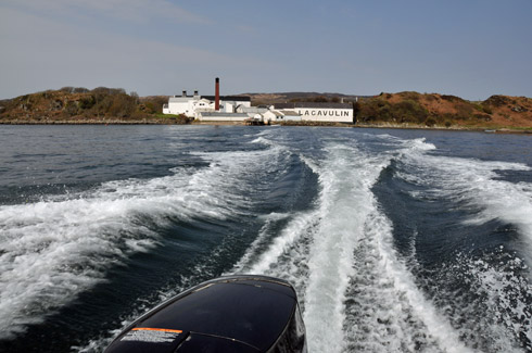 Picture of Lagavulin distillery on Islay seen from a speeding motorboat