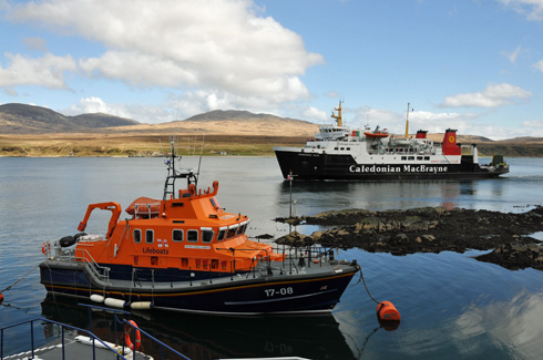 Picture of an RNLI lifeboat and a Calmac ferry in a sound
