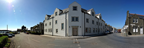 Picture of a panoramic view of the under construction Islay Hotel in Port Ellen