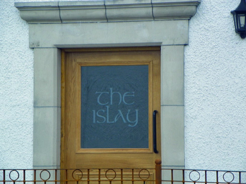 Picture of a hotel door with the name 'the islay' etched into the glass