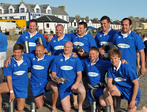 Picture of a male beach rugby team