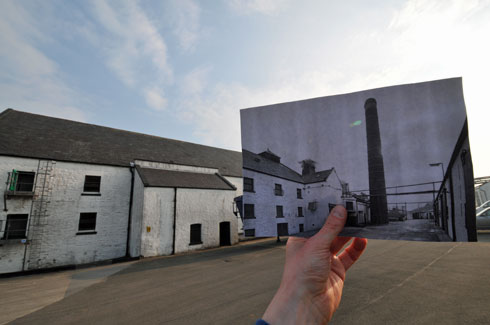Picture of a picture within a picture, old within new, of the yard at Laphroaig distillery