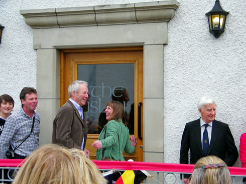 Picture of people standing in front of the newly opened the islay hotel, being asked to come in