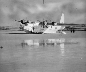 Old picture of a short Sunderland Mark II on the beach in Laggan Bay, Islay