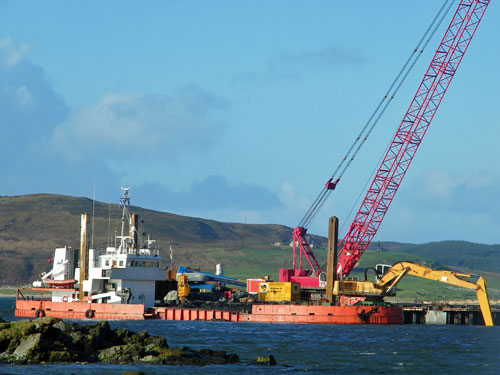 Picture of a dredger at work near Port Ellen pier on Islay