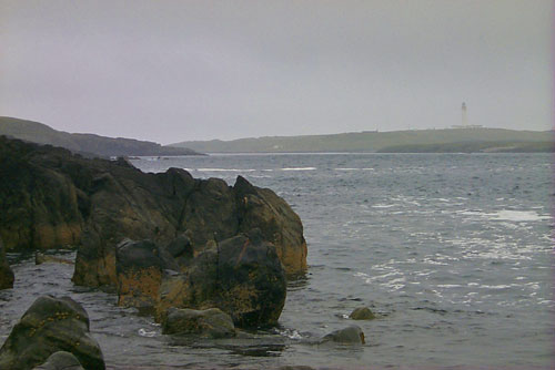 Picture of a view towards a lighthouse on a cloudy and misty day