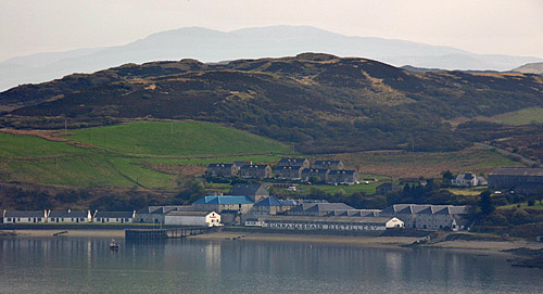 Picture of Bunnahabhain distillery seen from the hills across the bay