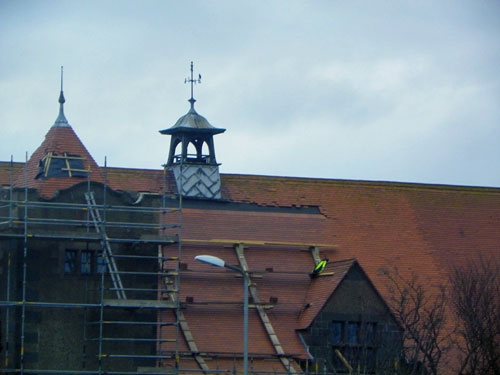 Picture of a building with roof repairs under way