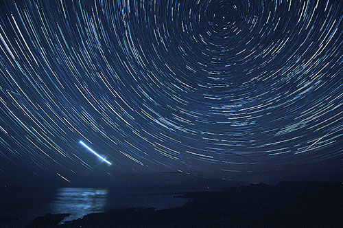 Picture of star trails over a wide bay