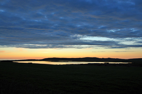 Picture of a freshwater loch in the gloaming
