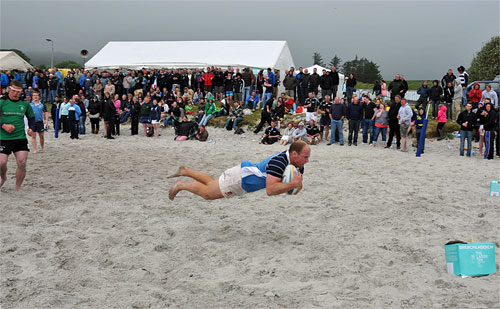 Picture of a flying try at the Islay beach rugby tournament