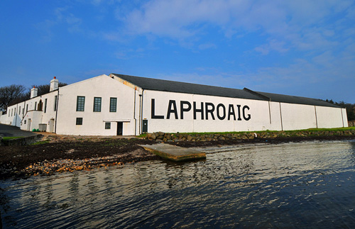 Picture of a view of the Laphroaig distillery offices and some of the warehouses