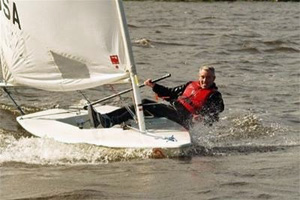 Picture of a man sailing a Laser dinghy