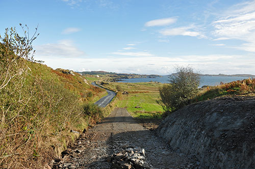 Picture of a view from a coastal path towards a distillery