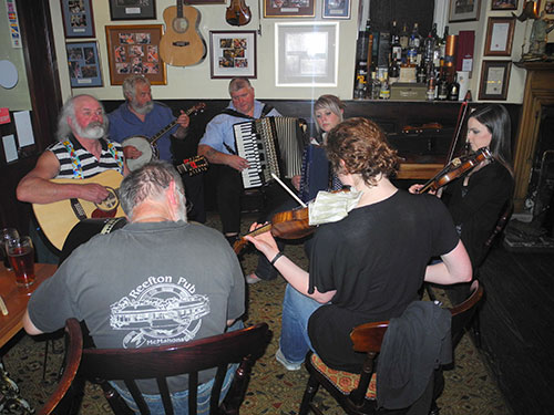 Picture of a group of musicians playing traditional Scottish music