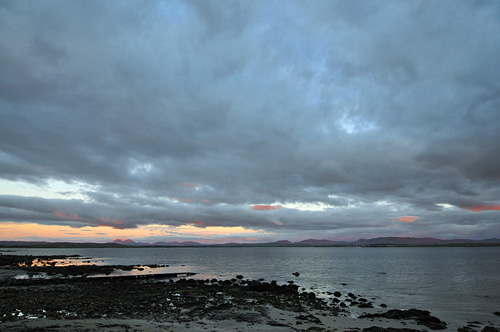 Picture of dramatic colourful clouds over a sea loch