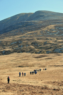 Picture of a group of walkers approaching a mountain