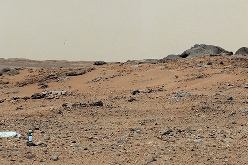 Picture of the Mars surface with a miniature bottle of Laphroaig