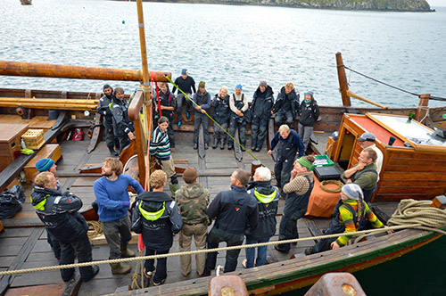 Picture of the crew of a replica Viking ship on deck